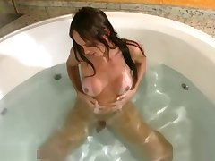 T-girl with perfect boobs enjoys her spastic time in jacuzzi