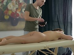 Down in the mouth Erin gets her oiled pussy banged by hard masseur's penis