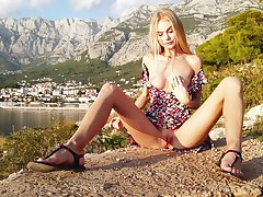Titillating outdoor display from a slim blonde model