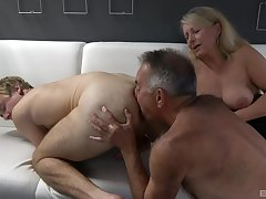 Dirty bisexual threesome between a dirty older couple coupled with a younger scrounger